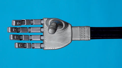 A Mechanical Arm Flexes Fingers Gray Cyborg Arm Came To Life and Began To Move on a Blue Background Live Action