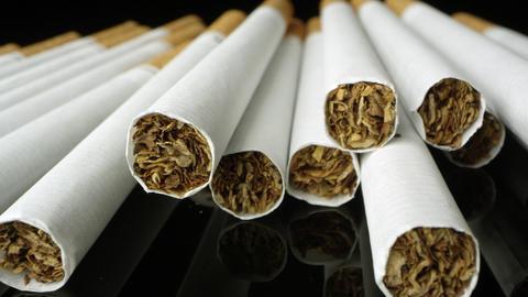 Up close macro shot panning across cigarettes Live Action
