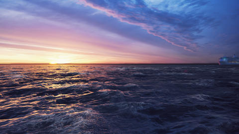 The camera flies towards a Luxury cruise ship sailing from the port at sunrise across the sea Animation