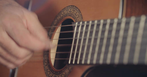 Musician playing an acoustic guitar in a recording studio Live Action