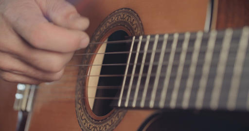 Musician playing acoustic guitar in a recording studio Live Action