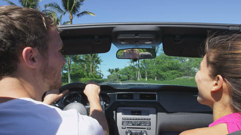 Couple driving car on road trip travel vacation Live Action