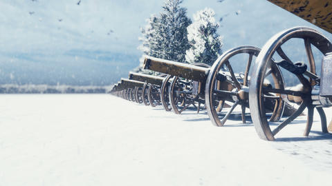 Cannons are on a winter field in the snow on a cloudy day, before the battle. Falling snow. Cannons Animation