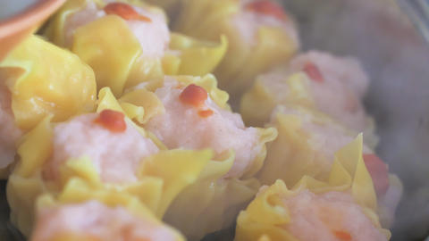 Steaming dimsum in the hot pot, selective focus shallow depth of field GIF