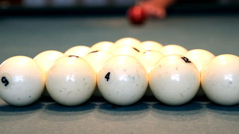 The opening of a Billiards shot. Man playing pool, snooker. Slow motion. Slow motion Live Action