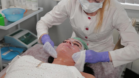 Professional beautician washes a woman before the procedure Live Action