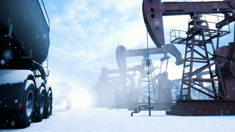 Industrial oil pumps operate in the winter and pump crude oil in an oil field. Oil trucks passing by Animation