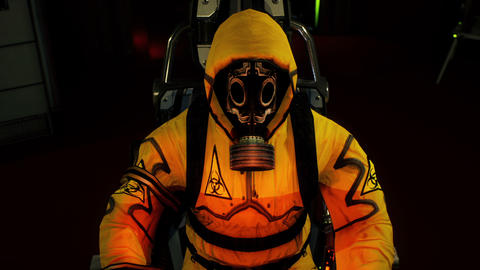 A medic in protective chemical clothing is working at a computer. A man in a yellow bacteriological Animation