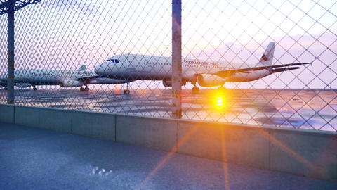 Commercial planes are parked at the airport and waiting for departure in the early morning Videos animados