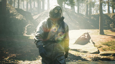 A Stalker in military protective clothing and a gas mask walks through a summer sunny forest. The Videos animados