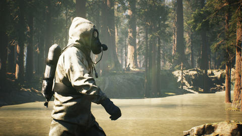 A Stalker in a chemical protection suit and a gas mask walks through a summer Sunny forest. The Videos animados