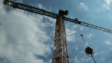Crane bottom view with clouds passing in the sky Live Action