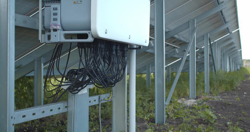 The wires going into the control panel on the back side of solar panel, 4k Live Action