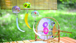 Japanese traditional paper fan and wind chimes Footage