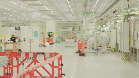 Workers in a construction project inside a clean room