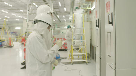 Workers in a construction project inside a clean room Footage