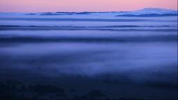 Morning mist over Kushiro marsh from the Hokuto Observatory in Hokkaido Footage