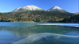 Frozen Lake Onneto, Mount Meakan and Mt. Akan-Fuji, Hokkaido, Japan Footage