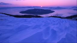 View of the sunrise over Lake Kussharo from Bihoro Pass, Hokkaido, Japan Footage