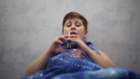 The boy is sick with a cold, he uses nasal spray Footage