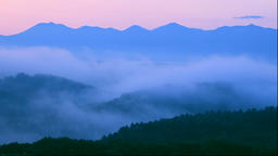Morning mist and the hills and the Tokachi Mountain Range in Hokkaido Footage