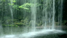View of Nabegataki waterfall from a cave, Kumamoto Prefecture, Japan Footage