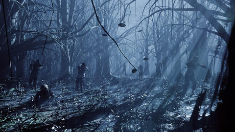 Zombies walk and crawl forward through the misty dark and scary forest. The concept of the Animation