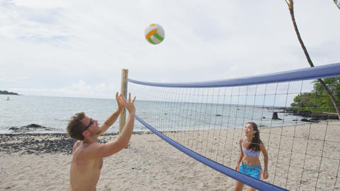 Couple playing beach volleyball - active lifestyle Live Action