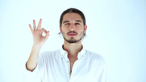 Portrait of handsome man looking at camera smiling, shows ok gesture, Demonstrates his agreement. ライブ動画