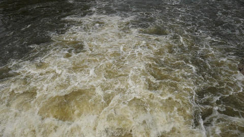 Water whirlpools bellow locks chamber, sluice on weir on river. Elbe river in Podebrady town, Live Action