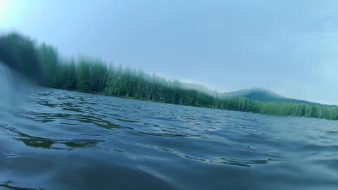 Diving in green natural water of lake, natural summer and swim resort. Toxic algae water pollution Live Action