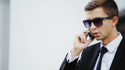 Young businessman talking on cell Footage