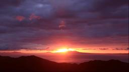 Sunrise behind Kunashir Island seen from the Shiretoko Pass in Hokkaido Footage