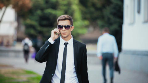 Young businessman talking on the phone Footage