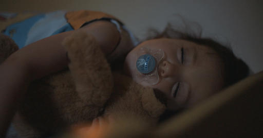 Little girl sleeping hugging her teddy bear Footage