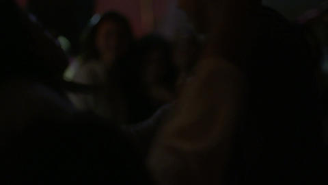 DJ playing music and people dancing in a dance party Footage