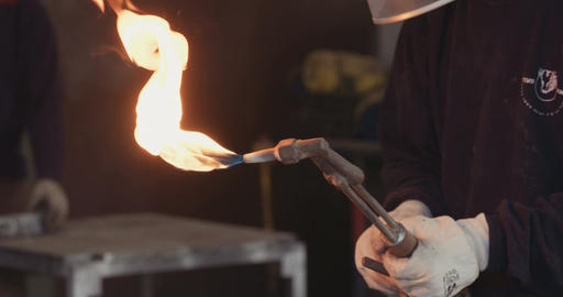 Welder using a cutting torch in a metal workshop Live Action