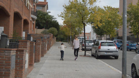 Woman Walking Her Child Footage