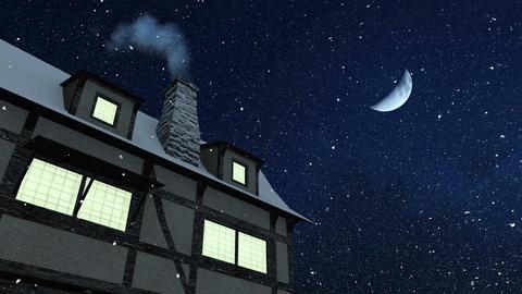 House with smoking chimney at snowfall winter night Animation