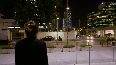 Business woman walking on the street and talking on the mobile phone Footage