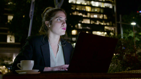 Business woman sitting and working on a laptop computer Footage
