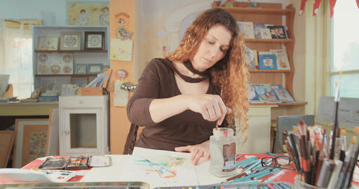 Female artist painting in her studio Footage