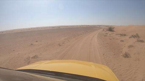Car is driving through oasis, car front window camera. Dubai Live Action