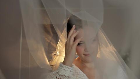 Lovely portrait of bride under veil. Face close-up. Pretty gorgeous woman Live Action