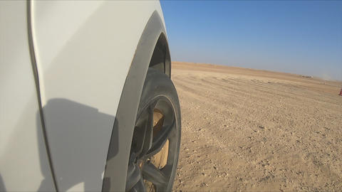 Car is driving in the desert. Camera from the car's right side Live Action