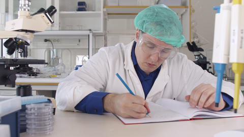 Medical Scientist Tired and Stressed in Laboratory Live Action