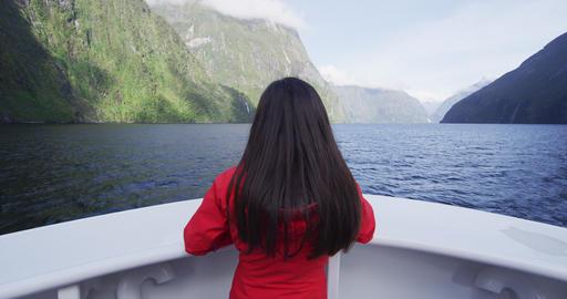 New Zealand tourist in Milford Sound Fiordland National Park. Tourist enjoying Live Action