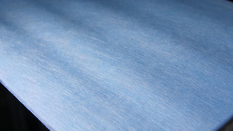 plain textile material for masks moves along production line Live Action