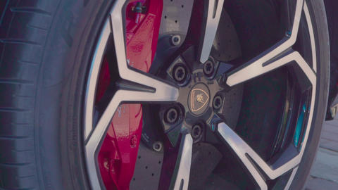 Lamborghini exterior. Red car clouseup Live Action