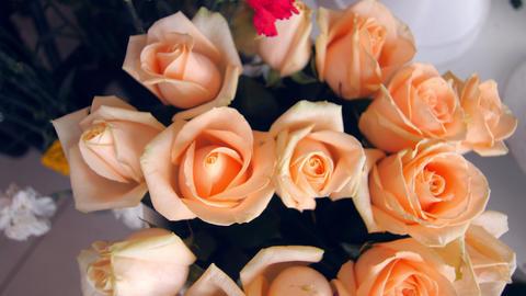 elegant beige rose bouquet on display in light floral shop Live Action